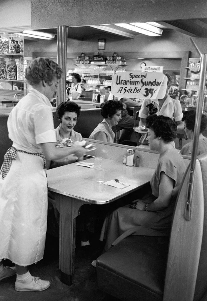 """<p>In this photo, a waitress brings """"Uranium Sundae"""" to a table. The sundae was named after Salt Lake City, Utah's booming uranium industry.</p>"""