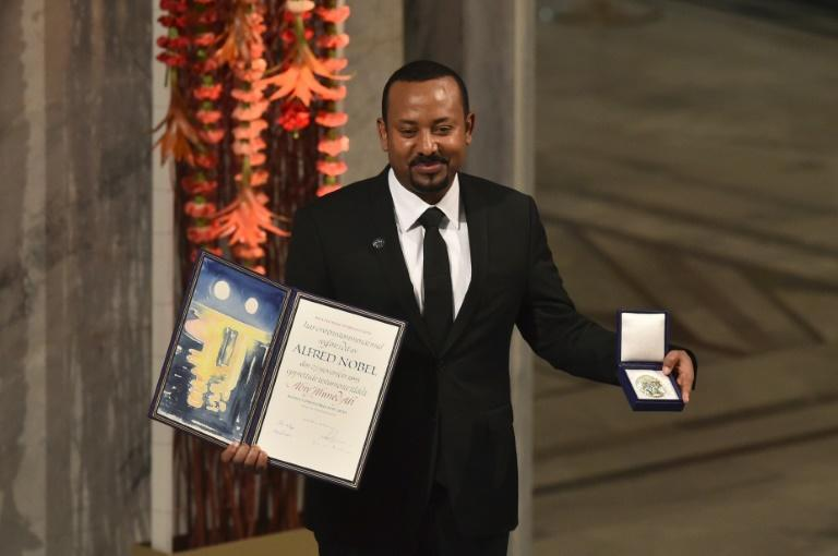 Prime Minister Abiy Ahmed, pictured with last year's Nobel Peace Prize, ordered the military operations in Tigray