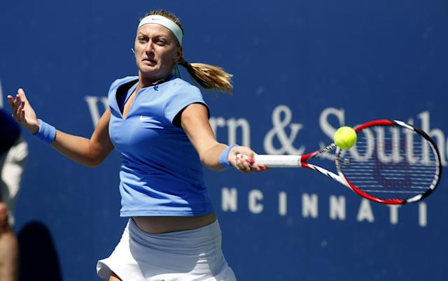 Petra Kvitova, from Czech Republic, returns a shot from Marina Erakovic, from New Zealand, during a match at the Western & Southern Open tennis tournament, Wednesday, Aug. 14, 2013, in Mason, Ohio. (AP Photo/David Kohl)