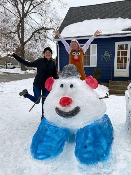 PHOTO: Katina Gustafson of East Providence, Rhode Island, stands in front of a Mr. Potato Head sculpture she made out of snow to inspire her students to go outside and play. (Katina Gustafson)