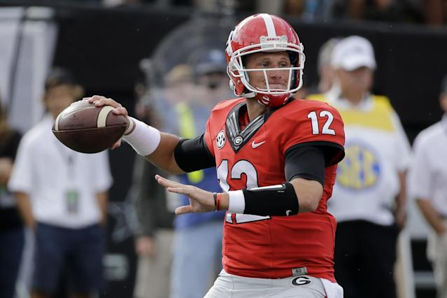 "<a class=""link rapid-noclick-resp"" href=""/ncaaf/players/225496/"" data-ylk=""slk:Brice Ramsey"">Brice Ramsey</a> has played both quarterback and punter at Georgia. (AP Photo/Mark Humphrey)"