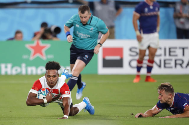 Japan's Kotaro Matsushima scores his side's second try during the Rugby World Cup Pool A game at Tokyo Stadium between Russia and Japan in Tokyo, Japan, Friday, Sept. 20, 2019. (AP Photo/Christophe Ena)