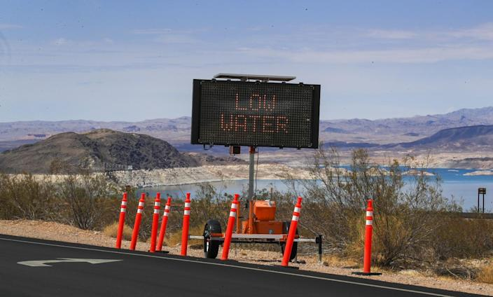 """An electronic roadside sign says """"low water"""""""