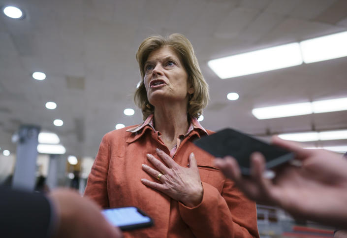"""FILE - In this June 22, 2021 file photo, U.S. Sen. Lisa Murkowski, R-Alaska, a negotiator in the infrastructure talks, pauses for reporters on Capitol Hill in Washington. Murkowski hasn't officially announced her re-election plans but her campaign released fundraising details, Wednesday, July 14, 2021, that an advisor says """"strongly positions,"""" a re-election bid by Murkowski. The campaign statement comes ahead of a filing deadline and days after Republican party leaders in Alaska endorsed newcomer Kelly Tshibaka for Senate. (AP Photo/J. Scott Applewhite, File)"""