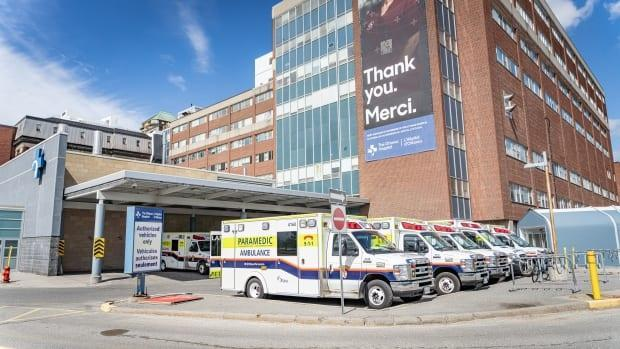 Ambulances sit outside The Ottawa Hospital's Civic campus on April 13, 2021. The hospital has now entered Level 2 on its pandemic response scale as COVID-19 cases continue to surge. (Brian Morris/CBC - image credit)