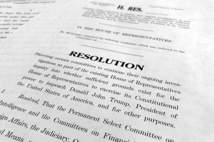The text of a House resolution released by the Democrats that authorizes the next phase of the impeachment inquiry against President Donald Trump is photographed in Washington, Tuesday, Oct. 29, 2019. (AP Photo/Jon Elswick)