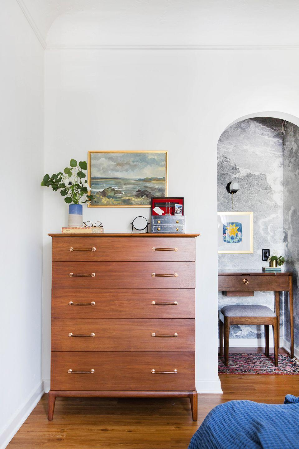"""<p>Leave it to <a href=""""https://stylebyemilyhenderson.com/"""" rel=""""nofollow noopener"""" target=""""_blank"""" data-ylk=""""slk:Emily Henderson"""" class=""""link rapid-noclick-resp"""">Emily Henderson</a> to transform a bedroom closet into an inspired work-from-home space. She opened it up by removing the doors, brought in a vanity turned desk and an upholstered stool to make it cozy, and secured task lighting to the wall to increase the functionality. The final piece in the puzzle: sunny artwork and cloud-print wallpaper to make the room feel like a daydream. </p>"""