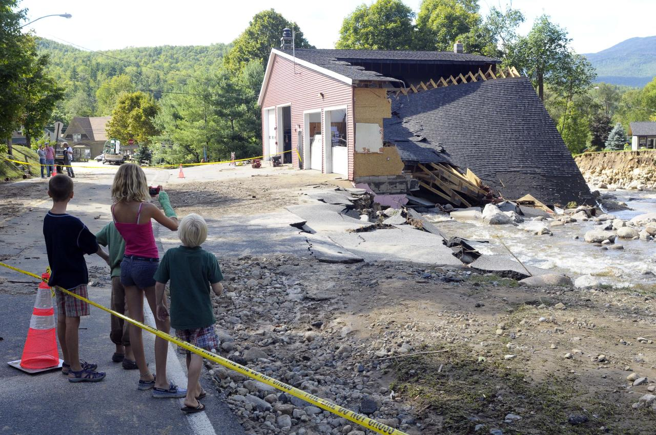 People view the damaged Town of Keene Fire Department caused by Tropical Storm Irene in the Town of Keene , N.Y., Monday, Aug. 29, 2011. (AP Photo/Hans Pennink)