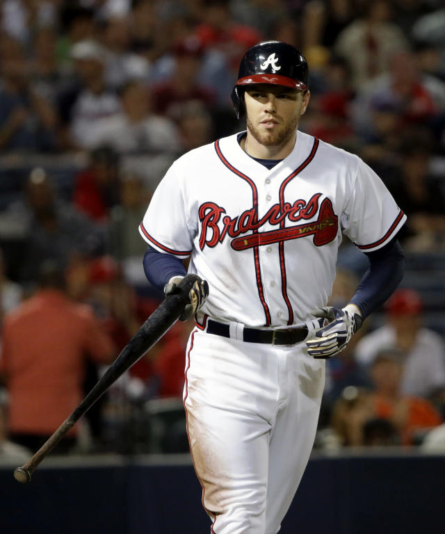 FILE - In this Sept. 26, 2013, file photo, Atlanta Braves' Freddie Freeman heads to first base after drawing a walk in the second inning of a baseball game against the Philadelphia Phillies in Atlanta. A person familiar with the talks says the Atlanta Braves have reached an agreement on an eight-year deal with Freeman that will be worth about $125 million. The person confirmed the agreement to The Associated Press on condition of anonymity on Tuesday, Feb. 4, 2014, because the Braves haven't announced the deal, which is subject to a successful physical. (AP Photo/David Goldman, File)