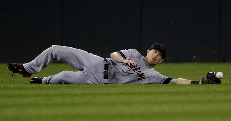 Cleveland Indians center fielder Drew Stubbs loses a ball hit by Chicago White Sox's Josh Phegley during the seventh inning of a baseball game on Sunday, Sept. 15, 2013, in Chicago. (AP Photo/Andrew A. Nelles)
