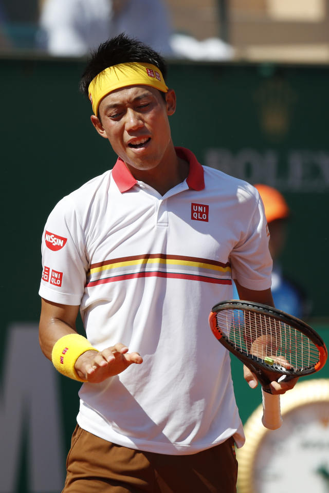 Japan's Kei Nishikori gestures after missing a return against Spain's Rafael Nadal during the men's singles final match of the Monte Carlo Tennis Masters tournament in Monaco, Sunday April 22, 2018. (AP Photo/Christophe Ena)