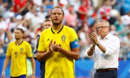 FILE PHOTO: Soccer Football - World Cup - Quarter Final - Sweden vs England - Samara Arena, Samara, Russia - July 7, 2018 Sweden coach Janne Andersson and Andreas Granqvist applaud the fans at the end of the match REUTERS/Michael Dalder