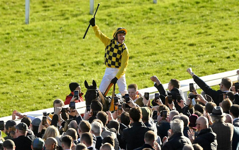 Paul Townend celebrates on Al Boum Photo after winning the Magners Cheltenham Gold Cup Chase - PA
