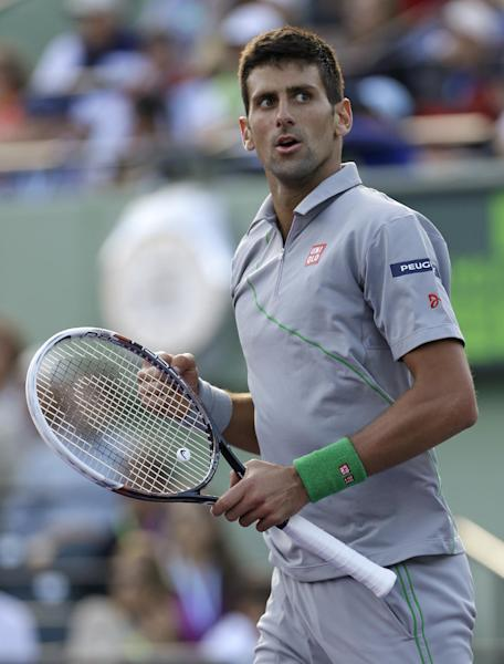 Novak Djokovic, of Serbia, pumps his fist after winning 7-5, 6-3 against Andy Murray, of Britain, at the Sony Open Tennis tournament in Key Biscayne, Fla., Wednesday, March 26, 2014. (AP Photo/Alan Diaz)