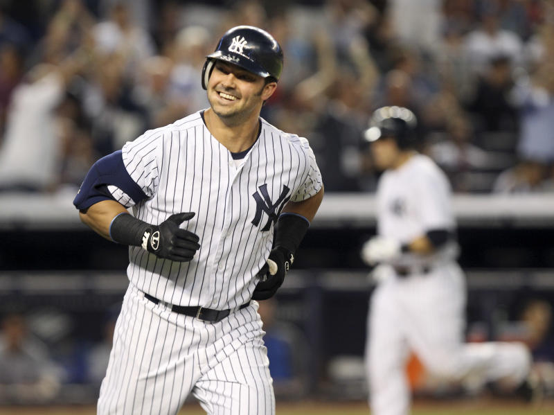 New York Yankees' Nick Swisher smiles while running the bases after hitting a grand slam during the third inning of the baseball game against the Texas Rangers Monday, Aug. 13, 2012 at Yankee Stadium in New York. (AP Photo/Seth Wenig)