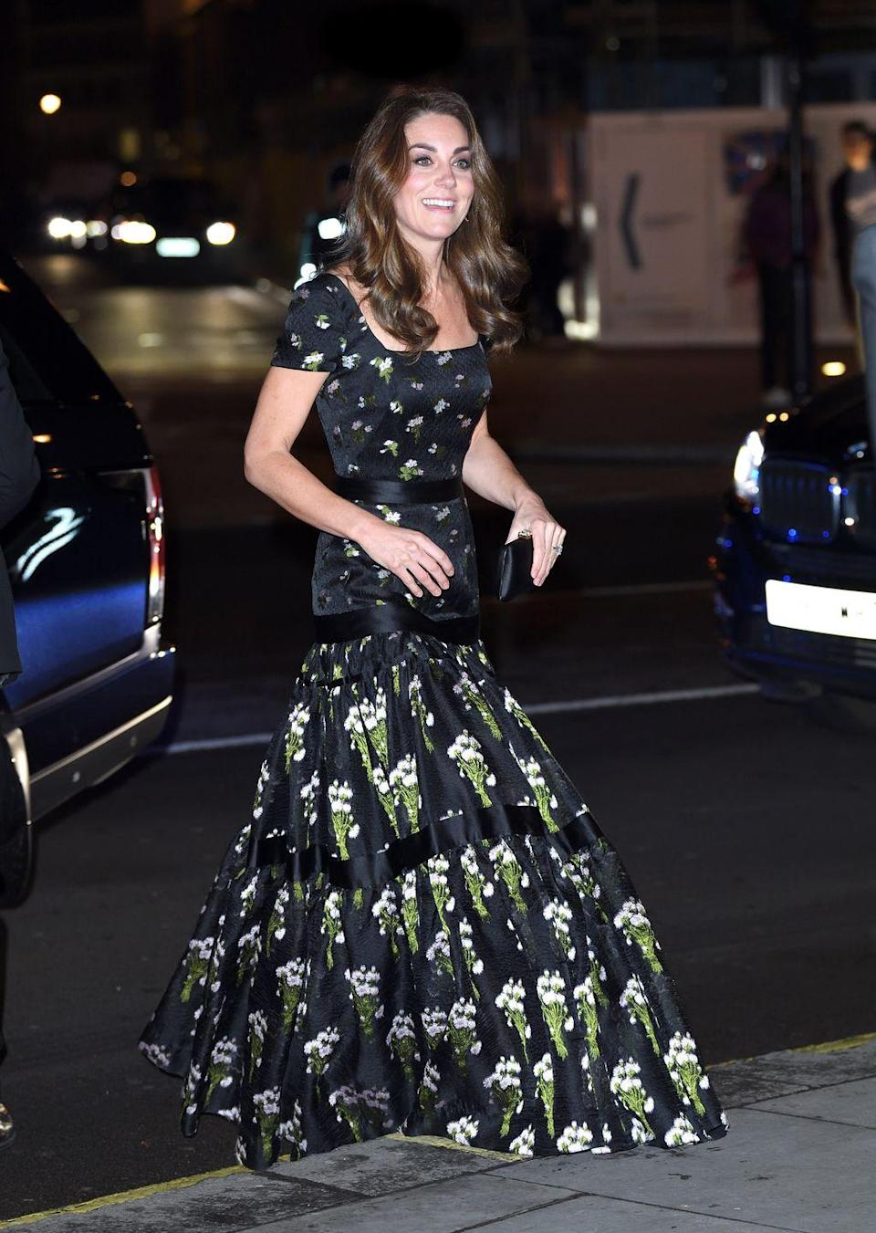 """<p>Kate Middleton attended the <a href=""""https://www.townandcountrymag.com/style/fashion-trends/a26789213/kate-middleton-alexander-mcqueen-national-portrait-gallery-gala-2019/"""" rel=""""nofollow noopener"""" target=""""_blank"""" data-ylk=""""slk:National Portrait Gallery Gala"""" class=""""link rapid-noclick-resp"""">National Portrait Gallery Gala</a> wearing a re-tailored Alexander McQueen dress, that she previously wore in 2017, <a href=""""https://www.neimanmarcus.com/c/designers-kiki-mcdonough-cat46520802"""" rel=""""nofollow noopener"""" target=""""_blank"""" data-ylk=""""slk:Kiki McDonough earrings"""" class=""""link rapid-noclick-resp"""">Kiki McDonough earrings</a>, and a Prada clutch. </p>"""