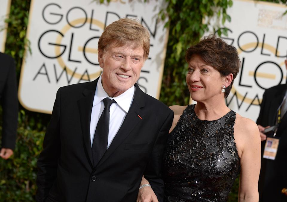 Robert Redford, left, and Sibylle Szaggars arrive at the 71st annual Golden Globe Awards at the Beverly Hilton Hotel on Sunday, Jan. 12, 2014, in Beverly Hills, Calif. (Photo by Jordan Strauss/Invision/AP)