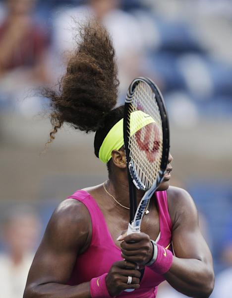 Serena Williams returns a shot to Italy's Sara Errani during a semifinal match at the 2012 US Open tennis tournament, Friday, Sept. 7, 2012, in New York. (AP Photo/Charles Krupa)