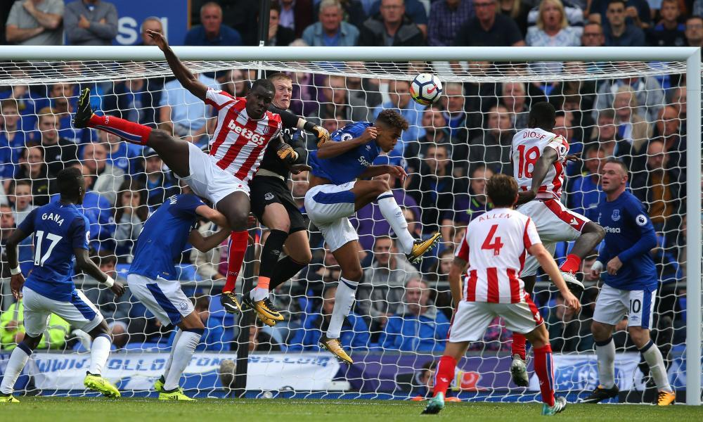 The Everton goalkeeper Jordan Pickford punches the ball clear against Stoke City