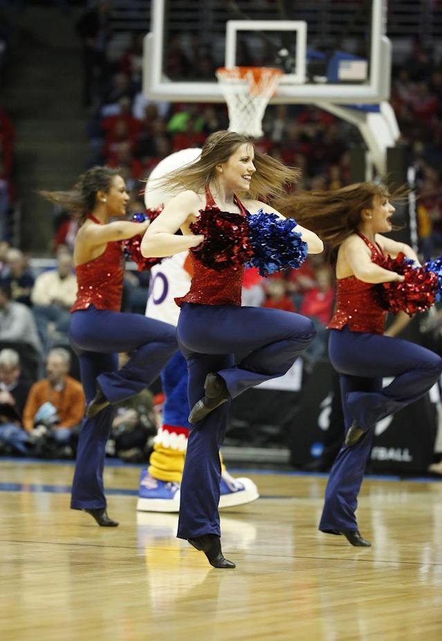 American cheerleaders perform during the first half of a second-round game in the NCAA college basketball tournament Thursday, March 20, 2014, in Milwaukee. (AP Photo/Jeffrey Phelps)
