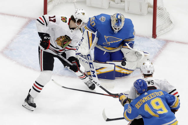 Chicago Blackhawks' Dylan Strome (17) watches the puck as St. Louis Blues goaltender Jordan Binnington (50) defends during the second period of an NHL hockey game Saturday, Dec. 14, 2019, in St. Louis. (AP Photo/Jeff Roberson)