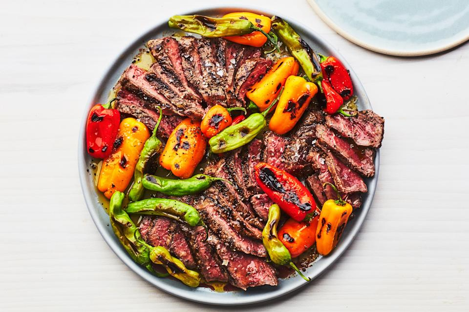 "Top grilled strip steaks with charred shishito and mini bell peppers for a sweet, smoky, occasionally spicy summer dinner. <a href=""https://www.epicurious.com/recipes/food/views/grilled-steak-and-mixed-peppers?mbid=synd_yahoo_rss"" rel=""nofollow noopener"" target=""_blank"" data-ylk=""slk:See recipe."" class=""link rapid-noclick-resp"">See recipe.</a>"