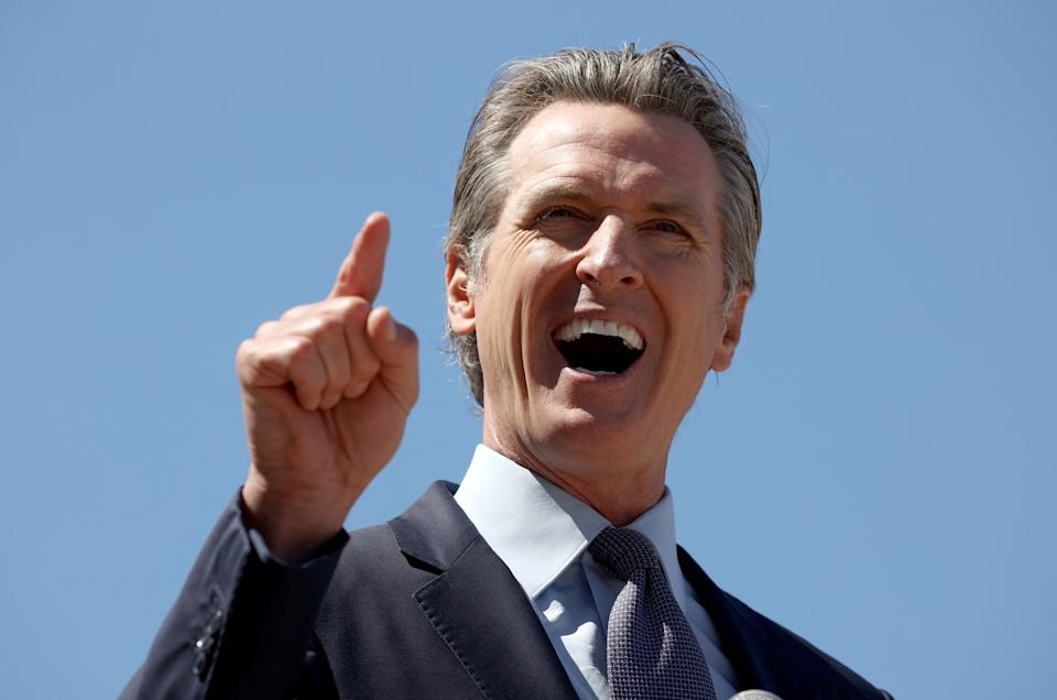 California Gov. Gavin Newsom gestures with a pointed finger while speaking