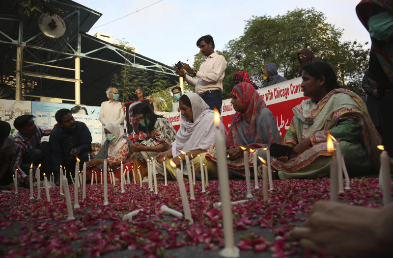 People attend candlelight vigil for victims of the crash of a state-run Pakistan International Airlines plane, in Karachi, Pakistan, Thursday , May 28, 2020. (AP Photo/Fareed Khan)
