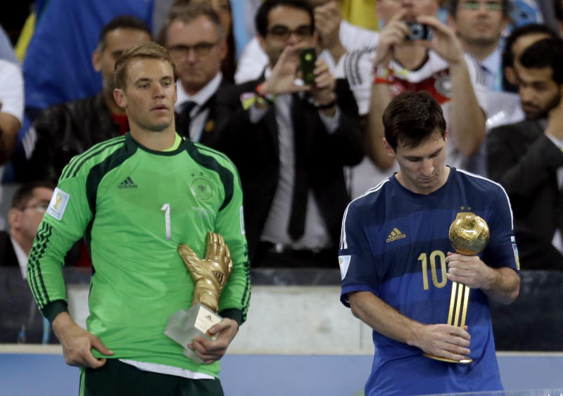 Germany's goalkeeper Manuel Neuer, recipient of the Golden Glove trophy, stands next to Argentina's Lionel Messi after he receive the Golden Ball trophy following Germany's 1-0 victory over Argentina after the World Cup final soccer match between Germany and Argentina at the Maracana Stadium in Rio de Janeiro, Brazil, Sunday, July 13, 2014