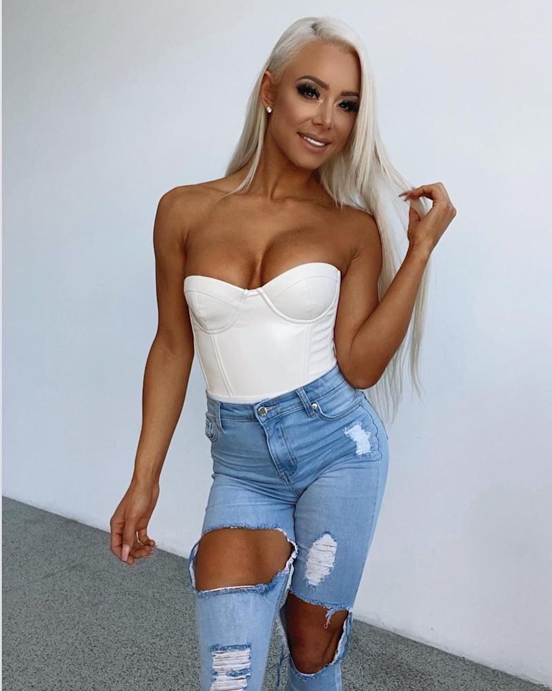 Lauren Simpson in a white bandeau top and ripped jeans