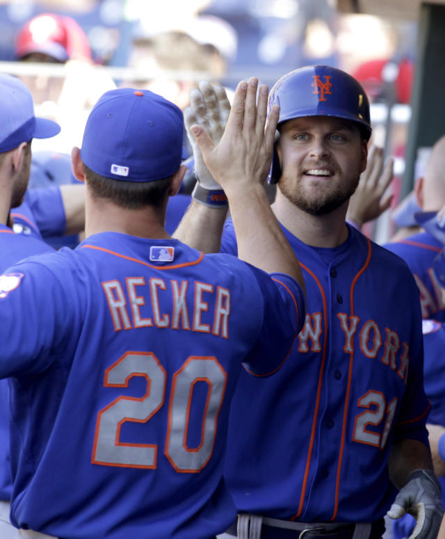 New York Mets' Lucas Duda (21) celebrates with Anthony Recker (20) after hitting a two run home run against the Philadelphia Phillies in the eleventh inning of a baseball game Sunday, June 1, 2014, in Philadelphia. The Mets won 4-3.(AP Photo/H. Rumph Jr)