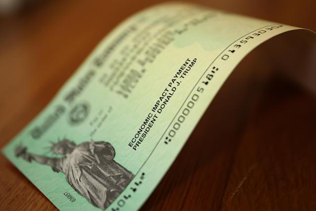 U.S. President Donald Trump's name appears on the coronavirus economic assistance checks that were sent to citizens across the country April 29, 2020 in Washington, DC. (Photo by Chip Somodevilla/Getty Images)