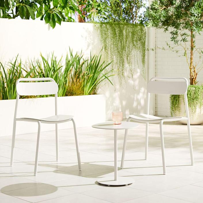 """Take your pick of white or sage for this simple little outdoor set. Even better? The pieces are easy to clean. $299, West Elm. <a href=""""https://www.westelm.com/products/outdoor-metal-stacking-chairs-sunny-side-table-set-h5303/?pkey=csmall-space-solutions"""" rel=""""nofollow noopener"""" target=""""_blank"""" data-ylk=""""slk:Get it now!"""" class=""""link rapid-noclick-resp"""">Get it now!</a>"""