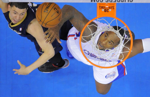 New Orleans Pelicans guard Austin Rivers, left, and Los Angeles Clippers forward Glen Davis look for a rebound during the first half of an NBA basketball game, Saturday, March 1, 2014, in Los Angeles. (AP Photo/Mark J. Terrill)