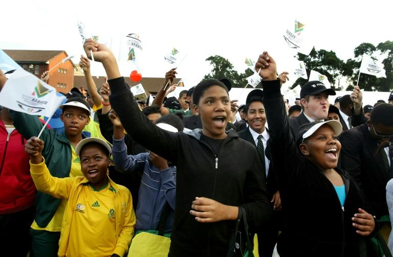 Primary school pupils react after Durban was officially named as host of the 2022 Commonwealth Games, in September 2015