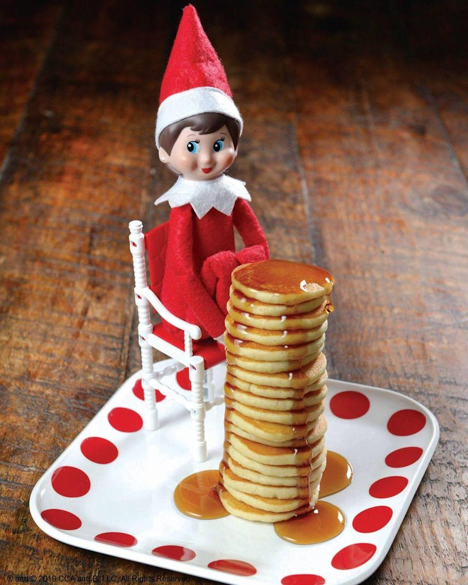 """<p>Here's an idea that's as delicious as it is adorable. Make a teeny-tiny stack of pancakes, then serve them up to your elf. Er, we mean... Let your elf make a teeny-tiny stack of pancakes!</p><p><strong>Get the tutorial at <a href=""""https://www.facebook.com/elfontheshelf/photos/a.287910360524/10161649225200525/?type=3&theater"""" rel=""""nofollow noopener"""" target=""""_blank"""" data-ylk=""""slk:Elf on the Shelf"""" class=""""link rapid-noclick-resp"""">Elf on the Shelf</a>.</strong></p><p><strong><a class=""""link rapid-noclick-resp"""" href=""""https://www.amazon.com/Stonewall-Kitchen-Buttermilk-Pancake-Waffle/dp/B00BP2RY42?tag=syn-yahoo-20&ascsubtag=%5Bartid%7C10050.g.22690552%5Bsrc%7Cyahoo-us"""" rel=""""nofollow noopener"""" target=""""_blank"""" data-ylk=""""slk:SHOP PANCAKE MIX"""">SHOP PANCAKE MIX</a><br></strong></p>"""