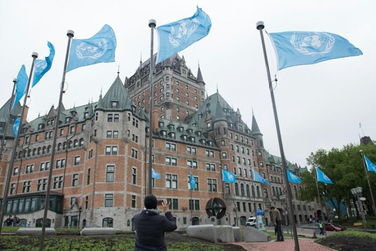 UN flags fly outside the Fairmont Le Chateau Frontenac in Quebec City, scene of a G7 summit, in  June 2018