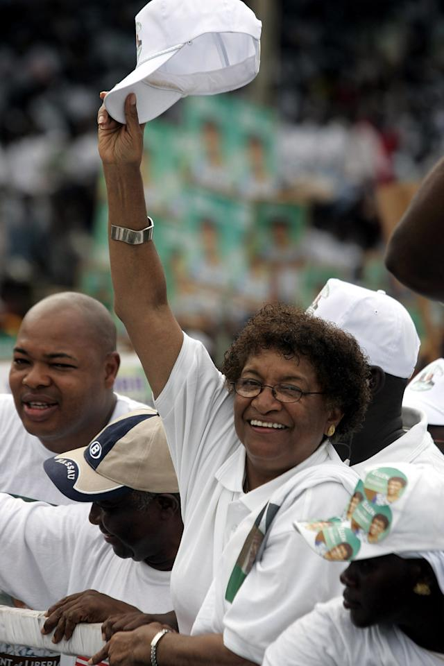 FILE - In this Oct. 6, 2005 file photo, Liberian Presidential candidate Ellen Johnson Sirleaf from the Unity Party 'UP' waves at her supporters during a rally in Monrovia, Liberia. Liberian President Ellen Johnson Sirleaf, Liberian activist Leymah Gbowee and Tawakkul Karman of Yemen have won the 2011 Nobel Peace Prize, the Norwegian Nobel Committee announced Friday, Oct. 7, 2011. (AP Photo/Schalk van Zuydam, File)