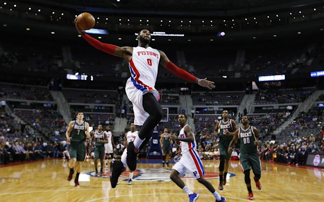 Detroit Pistons center Andre Drummond (0) dunks against the Milwaukee Bucks in the first half of an NBA basketball game in Auburn Hills, Mich., Monday, Nov. 25, 2013. (AP Photo/Paul Sancya)