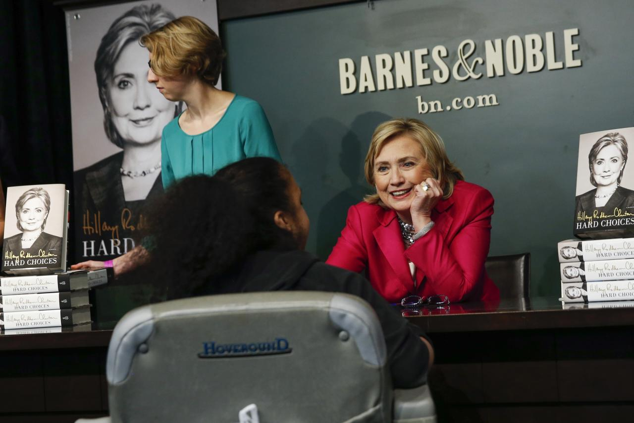 "Hillary Clinton talks with a girl during a signing of her new book ""Hard Choices"" in New York June 10, 2014. The book, Clinton's fifth with publisher Simon and Schuster, will give the former secretary of state a chance to shape the debate about her record in the Obama administration, and reintroduce herself to voters as she tours the country. REUTERS/Shannon Stapleton (UNITED STATES - Tags: POLITICS ENTERTAINMENT)"