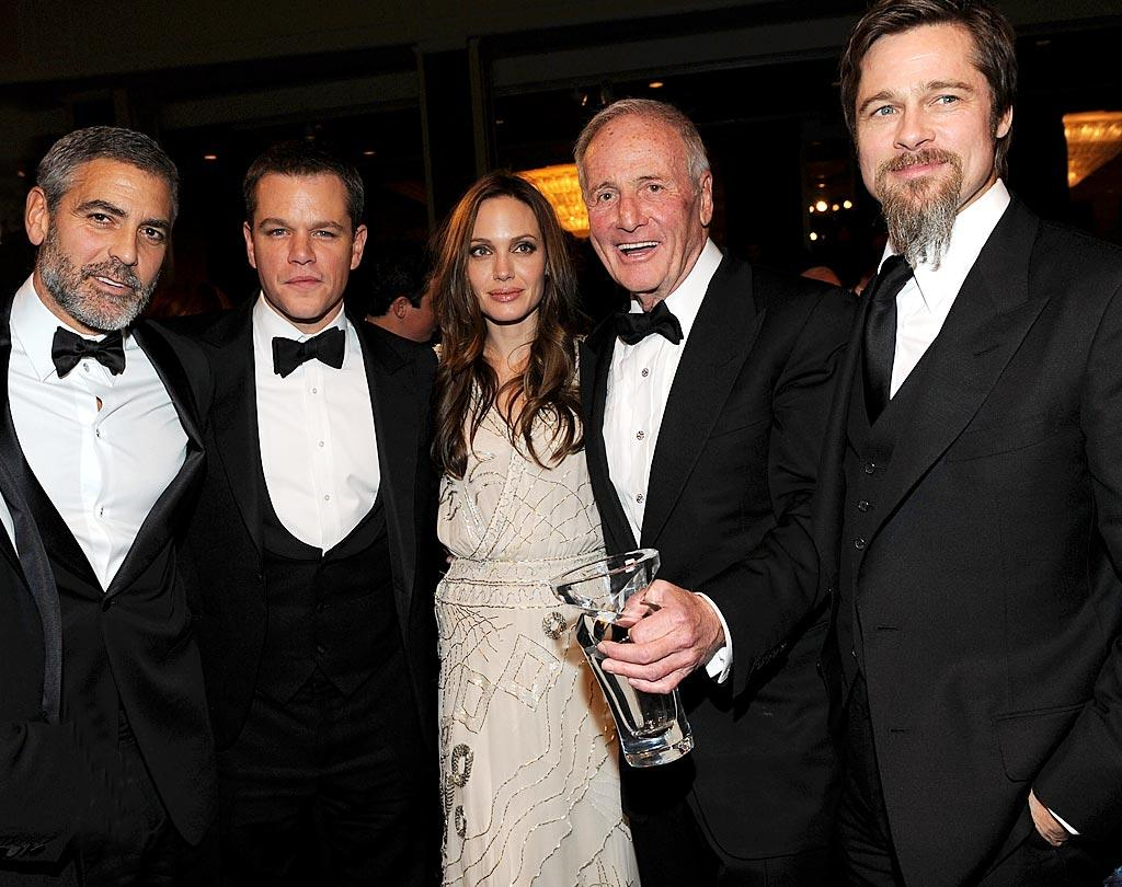 "The night's honoree, Jerry Weintraub strikes a pose with George Clooney, Matt Damon, Angelina Jolie, and Brad Pitt. Clooney said of Weintraub: ""Jerry doesn't just light up a room. He sets it on fire. He is a great producer. He is a great organizer. He is a great friend and he is truly the greatest showman on earth."" Kevin Mazur//<a href=""http://www.wireimage.com"" target=""new"">WireImage.com</a> - December 10, 2009"