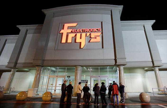 A small crowd gathers outside a Fry's Electronics store in Renton, Wash., on Oct. 21, 2009.