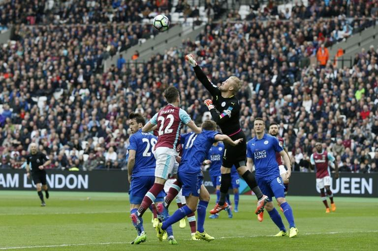 Leicester City's Kasper Schmeichel punches the ball away during the match against West Ham The London Stadium