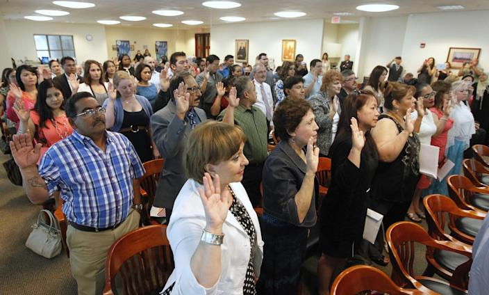 Participants take the Oath of Citizenship to become U.S. citizens in June 2014 at the United States District Court in Corpus Christi, Texas. (Rachel Denny Clow/Corpus Christi Caller-Times/AP)