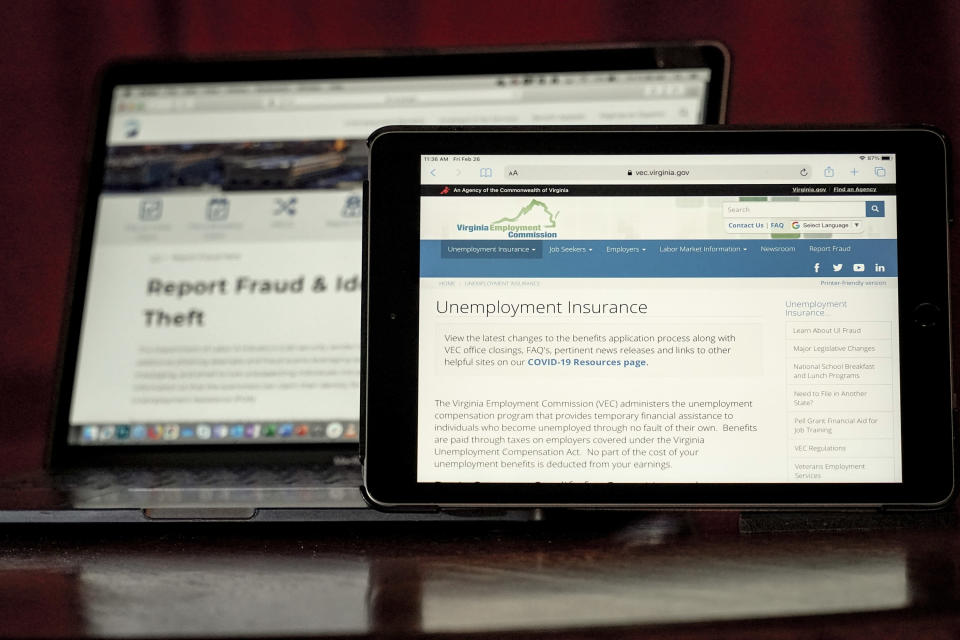 Web pages used to show information for collecting unemployment insurance in Virginia, right, and reporting fraud and identity theft in Pennsylvania, are displayed on the respective state web pages, Friday, Feb. 26, 2021, in Zelienople, Pa. Massive fraud in the nation's unemployment system is raising alarms even as President Joe Biden and Congress prepare to pour hundreds of billions more into expanded benefits for those left jobless by the coronavirus pandemic. (AP Photo/Keith Srakocic)