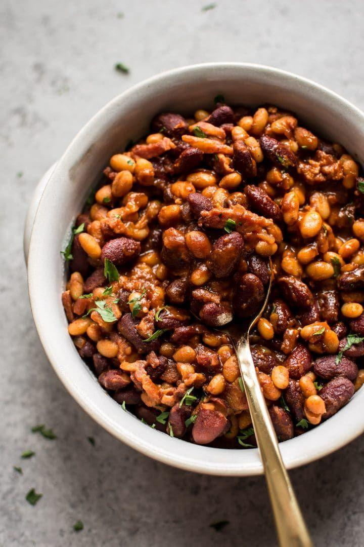 """<p>Get the <a href=""""https://www.saltandlavender.com/easy-baked-beans-with-bacon/"""" rel=""""nofollow noopener"""" target=""""_blank"""" data-ylk=""""slk:Baked Beans with Bacon"""" class=""""link rapid-noclick-resp"""">Baked Beans with Bacon</a> recipe.</p><p>Recipe from <a href=""""https://www.saltandlavender.com/"""" rel=""""nofollow noopener"""" target=""""_blank"""" data-ylk=""""slk:Salt & Lavender"""" class=""""link rapid-noclick-resp"""">Salt & Lavender</a>.</p>"""