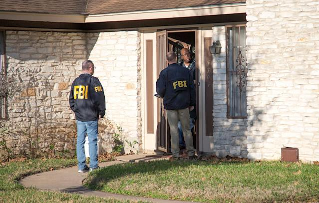 <p>Authorities are investigating the scene in East Austin, Texas, after a teenager was killed and a woman was injured in the second Austin package explosion in the past two weeks Monday, March 12, 2018. (Photo: Ricardo B. Brazziell/Austin American-Statesman via AP) </p>