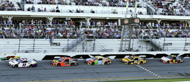 A group of Toyota's run in a single file from left, Denny Hamlin (11), Martin Truex Jr. (19), Kyle Busch (18),Erik Jones (20) and Christopher Bell (95) NASCAR Daytona 500 auto race at Daytona International Speedway, Monday, Feb. 17, 2020, in Daytona Beach, Fla. Sunday's race was postponed because of rain. (AP Photo/Terry Renna)