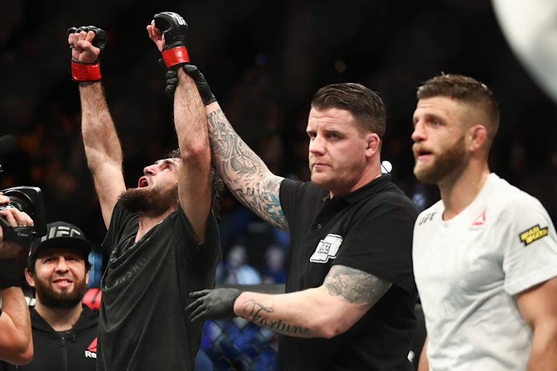 MOSCOW, RUSSIA NOVEMBER 10, 2019: UFC featherweight fighter Zabit Magomedsharipov (L) of Russia after winning a bout against Calvin Kattar (R) of the United States as part of the UFC Fight Night 163 mixed martial arts event, at CSKA Arena. Valery Sharifulin/TASS (Photo by Valery Sharifulin\TASS via Getty Images)