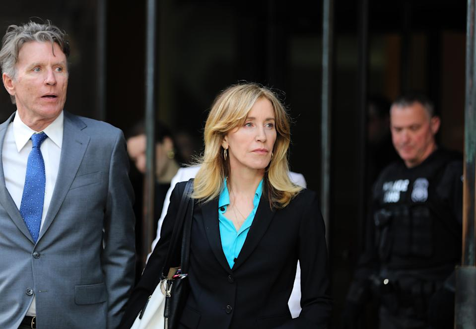 Actress Felicity Huffman, center, leaves the John Joseph Moakley United States Courthouse in Boston on April 3, 2019. (Photo by Pat Greenhouse/The Boston Globe via Getty Images)